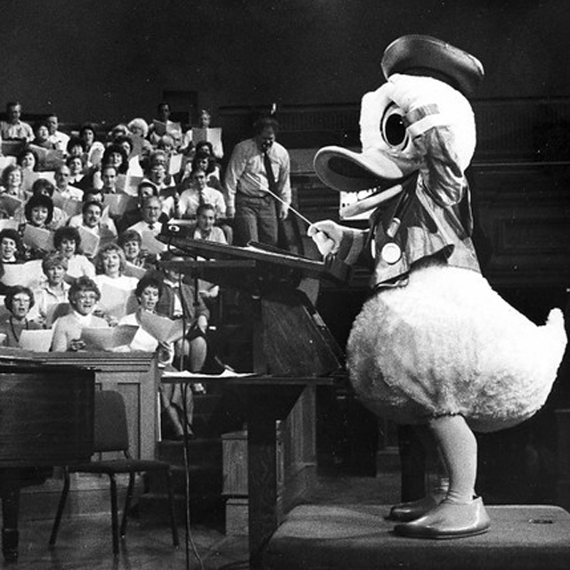 1988-march-donald-duck-conducts-choir.png