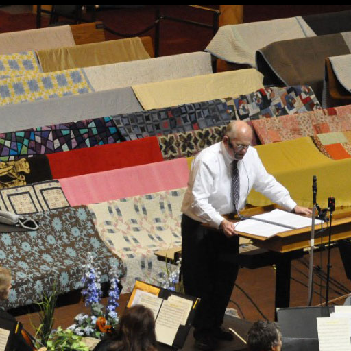 Why Are Quilts and Blankets Placed on Tabernacle Benches During Recording?